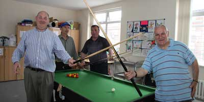 Mens Group playing Pool