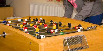 Image of Senior Youth Club members playing fuzeball game together